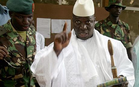 President Jammeh of Gambia showing his inked finger after voting