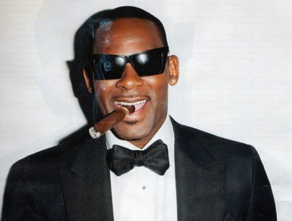 R Kelly with a cigar!