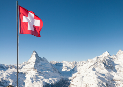 Swiss flag flying in the Alps