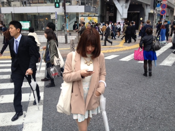 Using a smart phone at Shibuya Crossing