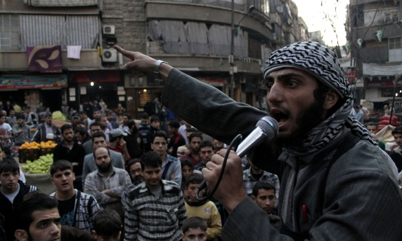 An ISIS member shouting at a crowd in Syria. This is copyright Karam al-Masri/AFP/Getty Images. I stole it from the Guardian article I wrote (see below for the link)