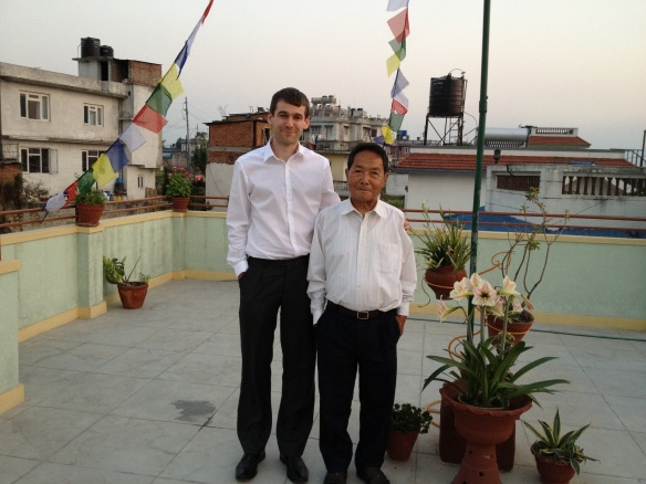 Myself with Amber Gurung on the roof of his house in Kathmandu. No, I shouldn't have worn a white shirt. Yes, I do look like his son!