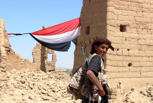 A Yemeni fighter stolen stands before his flag from Reuters' Angus McDowall. Sorry, Angus!