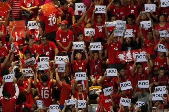 Hong Kong fans 'boo' the Chinese national anthem March of the Volunteers before a football/soccer match