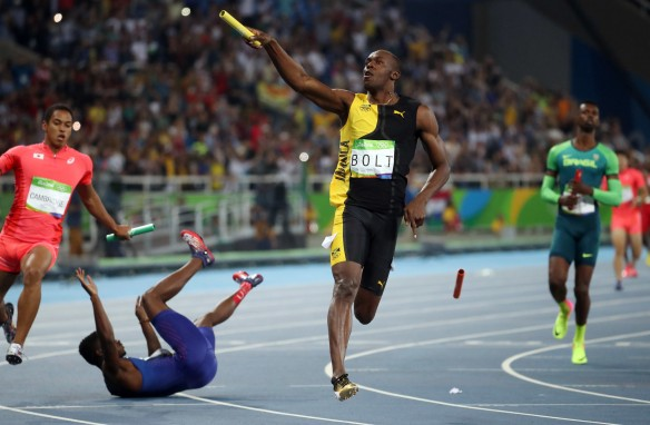 Bolt claiming his ninth gold as someone else falls over in shock