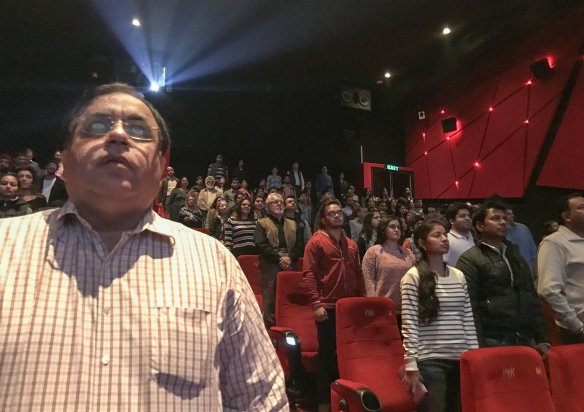 People standing for the anthem in a New Delhi cinema. This photo's stolen from Chandan Khanna of Agence France-Presse. Sorry, Chandan!